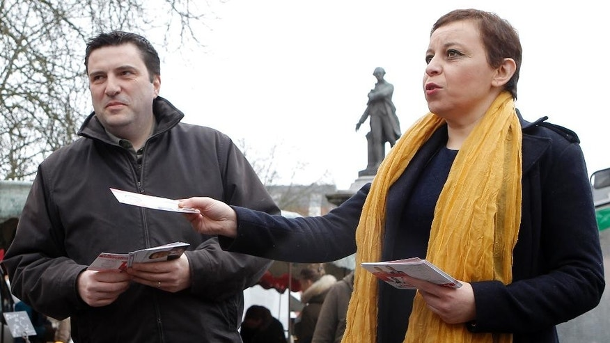 In this picture taken Sunday, March 1, 2015, Fatiha Ihallaine, 45, right, and Francis Andre, 45, candidates of French Socialist Party, campaign at an open market in Lille, northern France. In France's upcoming local elections, one thing is certain: Women will win half the seats. After years of largely failed efforts to get more women in politics, electoral officials devised a new rule for March 22 and March 29 elections for 4,108 local council members around France.(AP Photo/Michel Spingler)