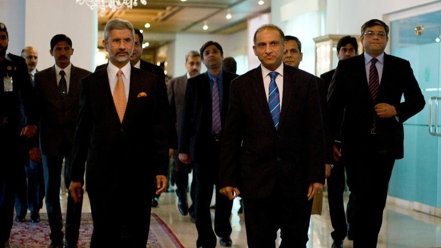 Indian Foreign Secretary Subrahmanyan Jaishankar, front left, arrives with his Pakistani counterpart Aizaz Chaudhry at the foreign ministry for talks in Islamabad, Pakistan, Tuesday, March 3, 2015. India's foreign secretary has arrived in Pakistan on a two-day visit, marking the first high-level meeting since talks broke down between the two nuclear-armed rivals last year. (AP Photo/B.K. Bangash)
