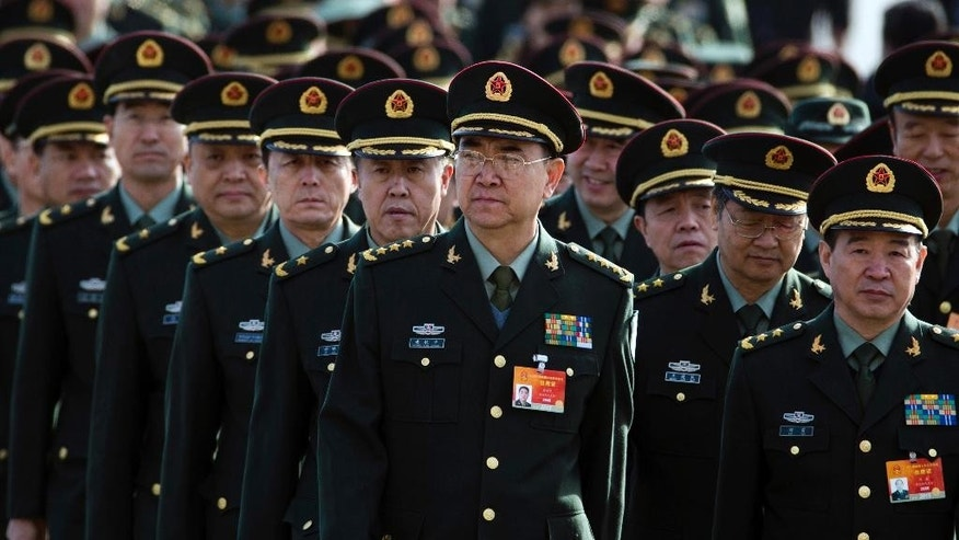 Chinese military officers arrive at the Great Hall of the People in Beijing, Wednesday, March 4, 2015. China's military budget will grow by about 10 percent in the coming year, a legislative spokeswoman said Wednesday, despite slowing economic growth that fell to 7.4 percent last year and is expected to further decline in 2015.(AP Photo/Ng Han Guan)