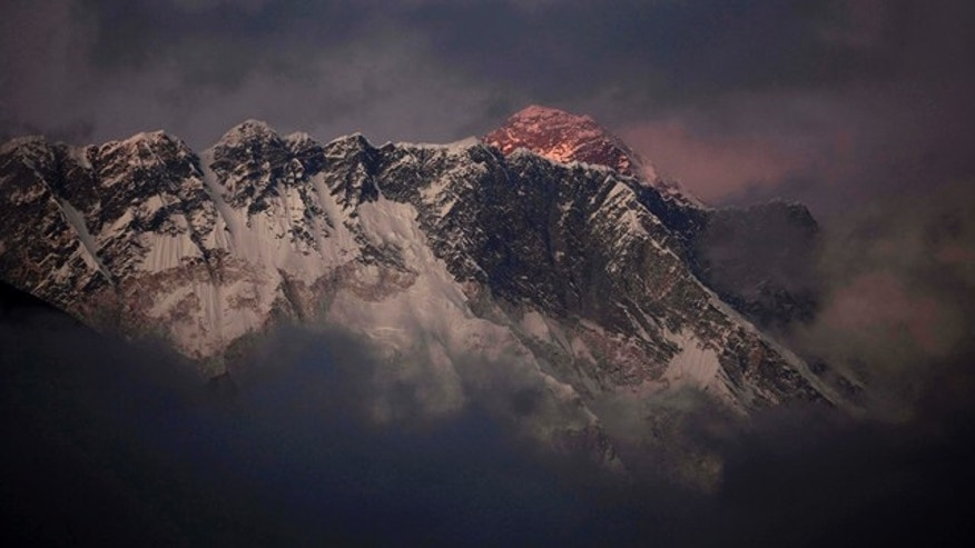FILE - In this Oct. 27, 2011 file photo, the last light of the day sets on Mount Everest as it rises behind Mount Nuptse as seen from Tengboche in the Himalays, Khumbu region, Nepal. (AP Photo/Kevin Frayer, File)