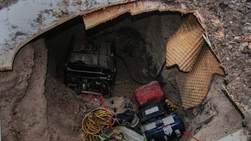 Feb. 24, 2015: A copy of a police photo of a tunnel found near York University is shown during a press conference in Toronto. (AP Photo/The Canadian Press, Chris Young)
