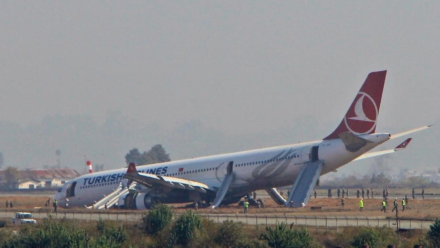 A Turkish Airlines jet is seen after it skidded off a slippery runway while landing in dense fog at Tribhuwan International Airport in Kathmandu, Nepal, Wednesday, March 4, 2015.The plane with 238 people on board was coming from Istanbul when the accident happened. Officials say passengers had bumps and bruises but no serious injuries. (AP Photo/Niranjan Shreshta)