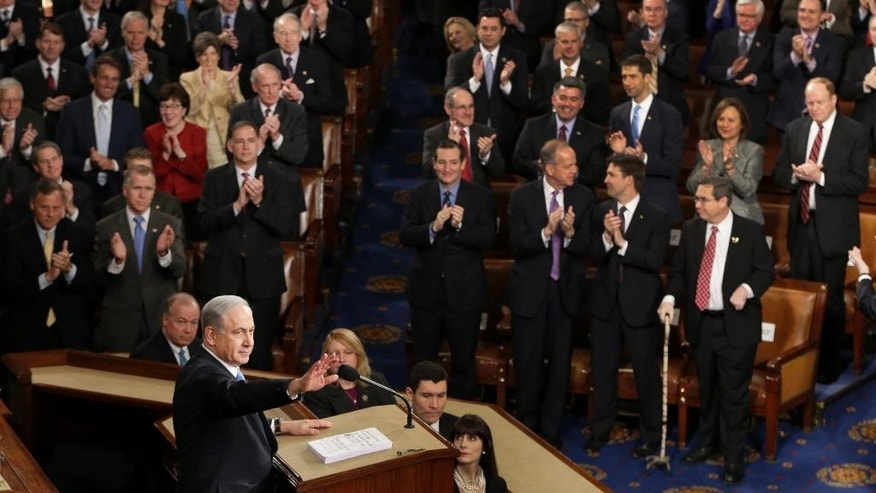 "Israeli Prime Minister Benjamin Netanyahu speaks before a joint meeting of Congress on Capitol Hill in Washington, Tuesday, March 3, 2015. In a speech that stirred political intrigue in two countries, Netanyahu told Congress that negotiations underway between Iran and the U.S. would ""all but guarantee"" that Tehran will get nuclear weapons, a step that the world must avoid at all costs. (AP Photo/J. Scott Applewhite)"