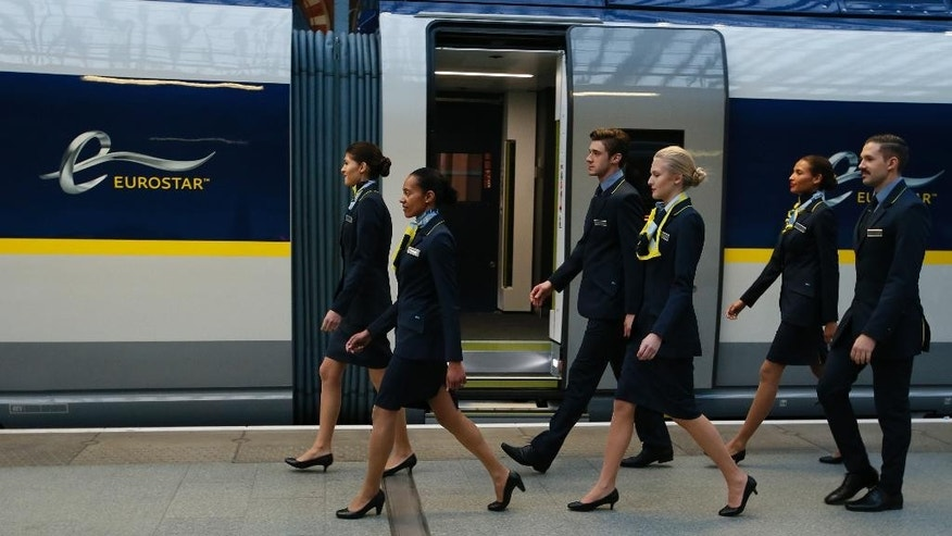 FILE In this Thursday, Nov. 13, 2014 file photo, Eurostar staff take part in a run through of their presentation prior to the launch of the new Eurostar e320 train at St Pancras station in London. Britain's government agreed Wednesday, March 4, 2015 to sell its stake in Eurostar, the high-speed rail service that connects London, Paris and Brussels, for 757 million pounds ($1.1 billion), wrapping up a major deal months before the general election. The Treasury said Wednesday a group of international investors, Canada's Caisse de depot et placement du Quebec and U.K.-based Hermes Infrastructure, agreed to buy the government's 40-percent stake for 585.1 million pounds. Eurostar agreed to redeem the government's preference share for an additional 172 million pounds. (AP Photo/Alastair Grant, File)