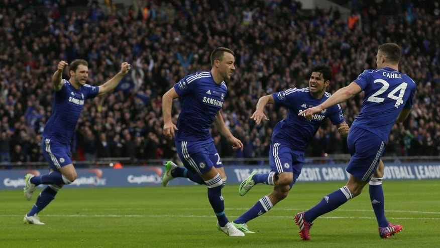 Chelsea's John Terry, second left, celebrates after scoring the opening goal of the game during the English League Cup Final between Tottenham Hotspur and Chelsea at Wembley stadium in London, Sunday, March,  1, 2015. (AP Photo/Tim Ireland)