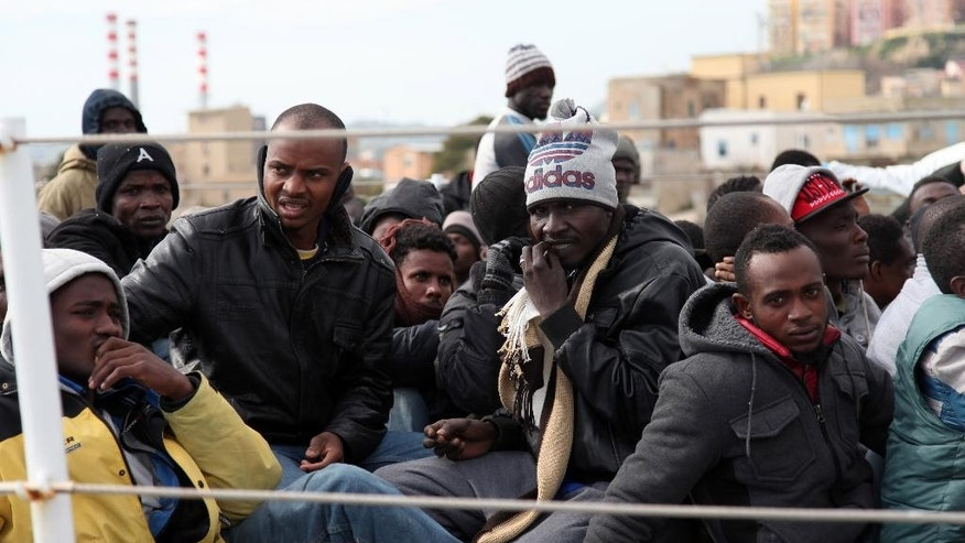 March 4, 2015: Migrants wait to disembark from an Italian Coast Guard vessel after being rescued in Porto Empedocle, Sicily, southern Italy. (AP)