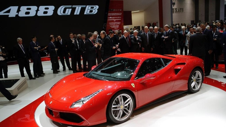 The new Ferrari 488 GTB is presented on the first press day of the Geneva International Motor Show Tuesday, March 3, 2015 in Geneva, Switzerland. The show opens its doors to the public March 5 through March 15. (AP Photo/Laurent Cipriani)