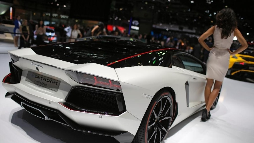 The new Lamborghini Aventador is presented on the first press day of the Geneva International Motor Show Tuesday, March 3, 2015 in Geneva, Switzerland. The show opens its doors to the public March 5 through March 15. (AP Photo/Laurent Cipriani)