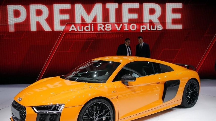 The new Audi R8 V-10 Plus is presented on the first press day of the Geneva International Motor Show Tuesday, March 3, 2015 in Geneva, Switzerland. The show opens its doors to the public March 5 through March 15. (AP Photo/Laurent Cipriani)