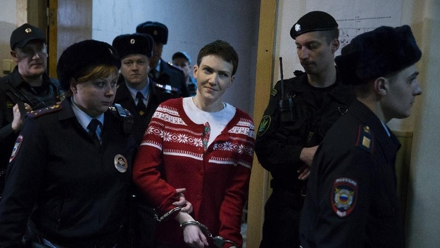 Ukrainian jailed military officer Nadezhda Savchenko, center, escorted from a court room in Moscow, Russia, Wednesday, March 4, 2015. A Russian court has rejected an appeal to release a Ukrainian military officer who has been on hunger strike since mid-December. The case of Nadezhda Savchenko has attracted high attention in recent weeks as concerns rise about her health. who has been on hunger strike since mid-December. The case of Nadezhda Savchenko has attracted high attention in recent weeks as concerns rise about her health. (AP Photo/Pavel Golovkin)