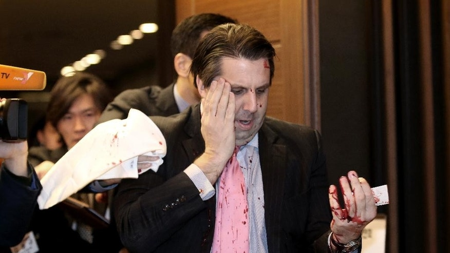 U.S. Ambassador to South Korea Mark Lippert leaves a lecture hall for a hospital in Seoul, South Korea, Thursday, March 5, 2015 after being attacked by a man. Lippert was attacked by a man wielding a razor and screaming that the rival Koreas should be unified, South Korean police and media said Thursday. (AP Photo/Yonhap, Kim Ju-Sung)  KOREA OUT