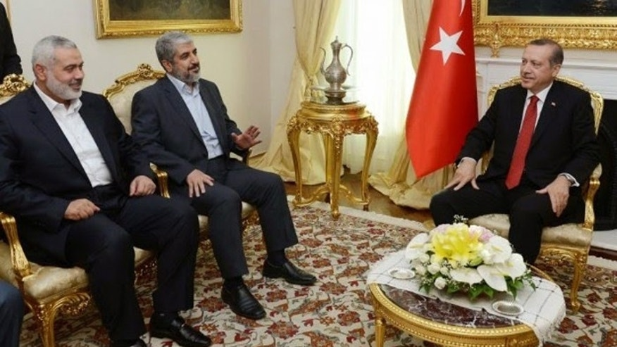 Turkish President Recep Tayyip Erdogan is shown here hosting Hamas leaders Khaled Mashaal and Ismail Haniyeh in June, 2013. Since this meeting Turkey's ties to Hamas have increased. [Turkish Prime Minister's Press Office]