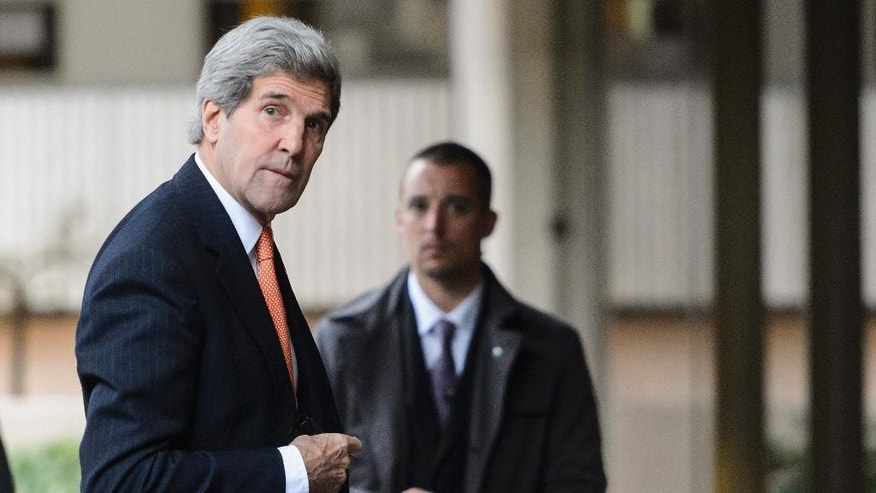 U.S. Secretary of State John Kerry arrives at a hotel for a bilateral meeting with Iranian Foreign Minister Mohammad Javad Zarif for a new round of nuclear talks, in Montreux, Switzerland, Wednesday, March 4, 2015. (AP Photo/Keystone, Jean-Christophe Bott)