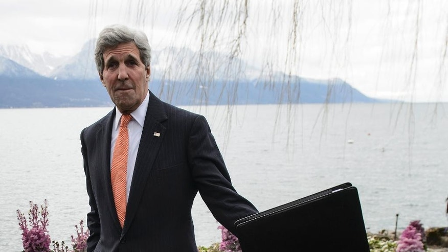 U.S. Secretary of State John Kerry takes a break from a bilateral meeting with Iranian Foreign Minister Mohammad Javad Zarif for a new round of nuclear talks, in Montreux, Switzerland, Wednesday, March 4, 2015. (AP Photo/Keystone, Jean-Christophe Bott)