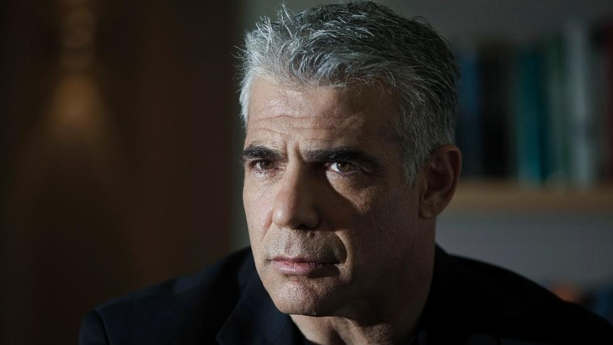 In this Wednesday, March 4, 2015 photo, Yair Lapid, leader of the Israeli political party Yesh Atid, listens during an  interview with The Associated Press in Tel Aviv, Israel. Lapid appeared destined to become a one-hit wonder in Israeli politics, as his centrist Yesh Atid party sank to unprecedented lows in polls ahead of the March 17 parliament elections. (AP Photo/Dan Balilty)