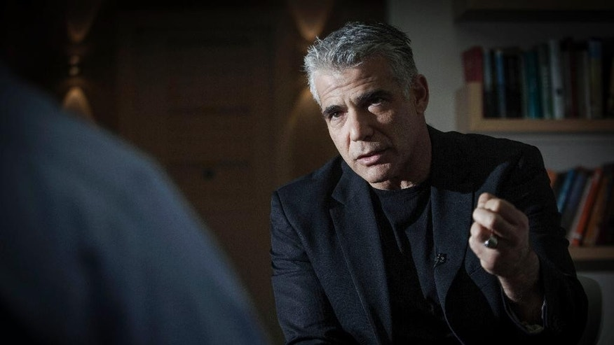 In this Wednesday, March 4, 2015 photo, Yair Lapid, leader of the Israeli political party Yesh Atid, talks during an  interview with The Associated Press in Tel Aviv, Israel. Lapid appeared destined to become a one-hit wonder in Israeli politics, as his centrist Yesh Atid party sank to unprecedented lows in polls ahead of the March 17 parliament elections. (AP Photo/Dan Balilty)