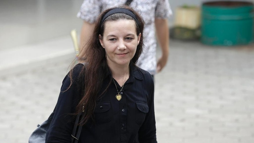 Sabine Atlaoui, the wife of Serge Atlaoui, a French national who is on death row after being convicted of drug offences, walks at Wijaya Pura port after visiting her husband in Cilacap, Central Java, Indonesia, Thursday, March 5, 2015. Indonesia plans executions of nine foreign drug criminals, including Atlaoui, despite clemency appeals from several of their governments. (AP Photo/Achmad Ibrahim)