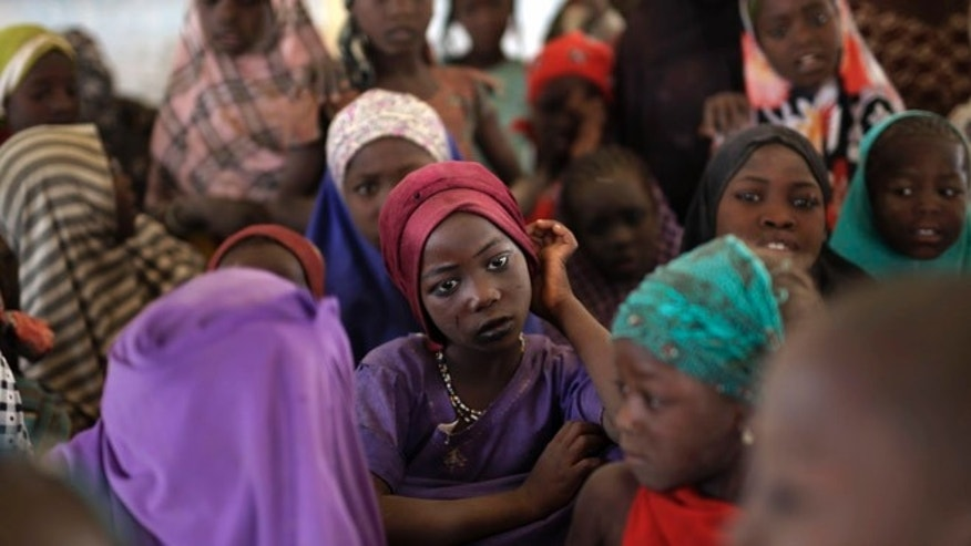 March 4, 2015: Nigerian girls who fled Boko Haram  to Chad gather in a school set up by UNICEF at the Baga Solo refugee camp in Chad. The camp, jointly run by the Chadian government and UNHCR, opened mid-January 2015 and hosts over 6,000 refugees.