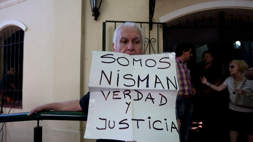 "A man holds a handwritten message that reads in Spanish; ""We are Nisman, Truth and Justice,"" in front of the building where Sandra Arroyo Salgado, ex-wife of the late Argentina prosecutor Alberto Nisman, held a press conference, in Buenos Aires, Argentina, Thursday, March 5, 2015. Salgado said that experts hired by the family of Argentine prosecutor concluded that he was killed and ruled out the hypothesis of suicide. (AP Photo/Natacha Pisarenko)"
