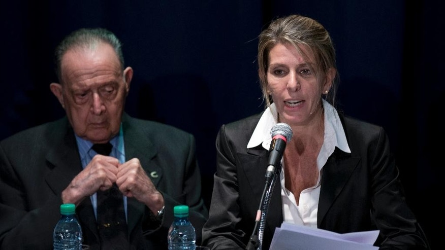 Sandra Arroyo Salgado, ex-wife of the late Argentina prosecutor Alberto Nisman, talks during a press conference beside forensic doctor Osvaldo Raffo, in Buenos Aires, Argentina, Thursday, March 5, 2015. Salgado said that experts hired by the family of Argentine prosecutor concluded that he was killed and ruled out the hypothesis of suicide. (AP Photo/Natacha Pisarenko)