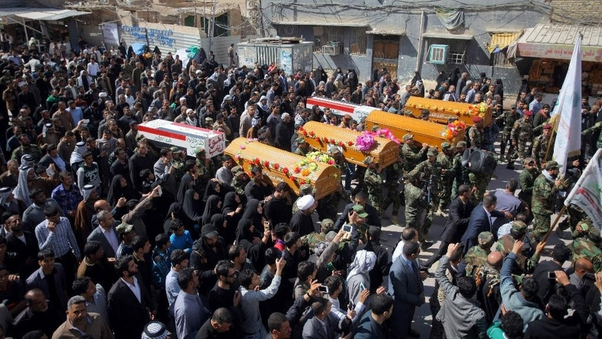 March 5, 2015: Mourners chant slogans against the Islamic State group during funeral procession of six mourners of a Shiite group, Asaib Ahl al-Haq, or League of the Righteous, who was killed in Tikrit fighting Islamic militants, in Najaf. (AP)