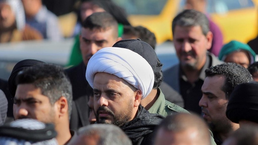 March 5, 2015: Qais al-Khazali, center, the leader of the Shiite group Asaib Ahl al-Haq, or League of the Righteous, attends funeral procession of six members  of his militia who were killed in Tikrit fighting Islamic militants, in Najaf. (AP)