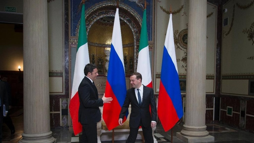 Russian Prime Minister Dmitry Medvedev, right, is about to shake hands with visiting Italian Prime Minister Matteo Renzi in Moscow, Russia, Thursday, March 5, 2015. (AP Photo/Ivan Sekretarev)