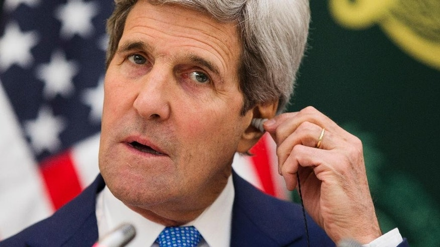 U.S. Secretary of State John Kerry puts in an ear piece for translation during a news conference with Saudi Foreign Minister Saud bin Faisal bin Abdulaziz Al Saud on Thursday, March 5, 2015, in Riyadh, Saudi Arabia. Kerry sought Thursday to ease Gulf Arab concerns about an emerging nuclear deal with Iran and explore ways to calm instability in Yemen and other troubled nations in the Middle East. (AP Photo/Evan Vucci, Pool)