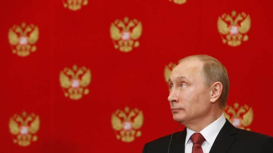 Russian President Vladimir Putin attends a news conference following a meeting with Italian Prime Minister Matteo Renzi in the Kremlin in Moscow, Russia, Thursday, March 5, 2015. Italy's prime minister visited Moscow on Thursday in a bid to repair ties that have been hurt by Russia-West tensions over Ukraine. (AP Photo/Sergei Karpukhin, Pool)
