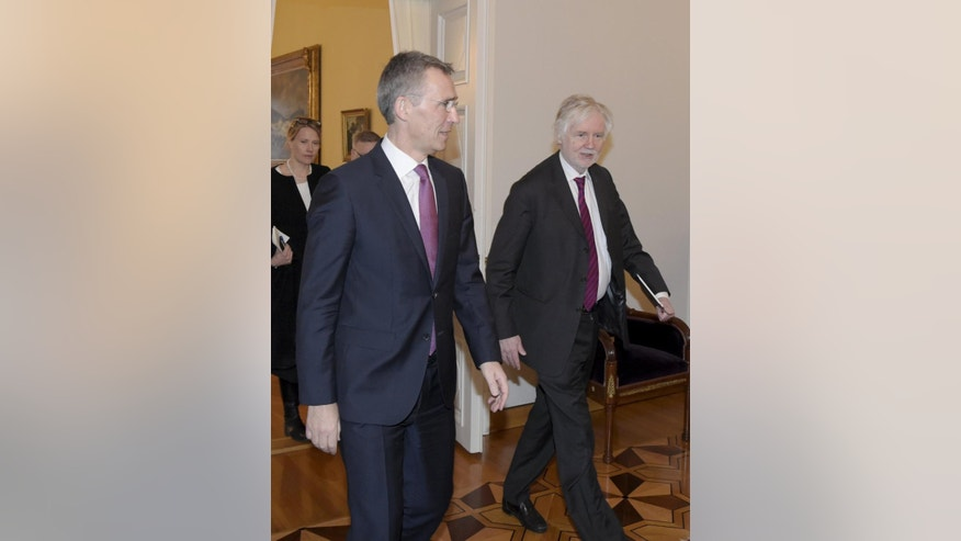 NATO Secretary General Jens Stoltenberg, left, walks with Finnish Foreign Minister Erkki Tuomioja before their meeting in Helsinki, Finland, Thursday, March 5, 2015. (AP Photo/Lehtikuva, Markku Ulander) FINLAND OUT, NO THIRD PARTY SALES