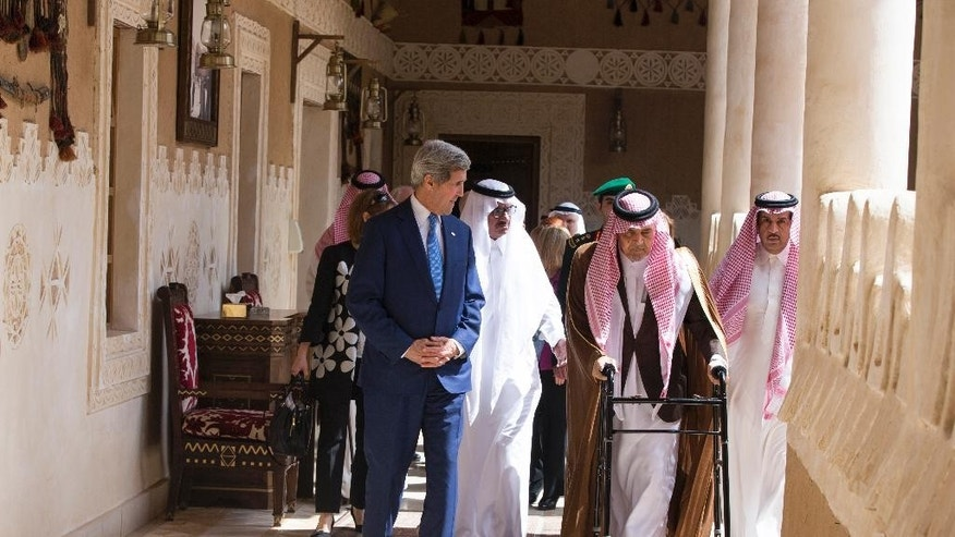 U.S. Secretary of State John Kerry walks with Saud bin Faisal bin Abdulaziz Al Saud, Foreign Minister of Saudi Arabia, before a visit with Saudi King Salman bin Abdulaziz al-Saud at Diriya Farm, on Thursday, March 5, 2015, in Diriya, Saudi Arabia. Kerry planned to meet with Arab Gulf state allies in Riyadh Thursday before sitting down with the foreign ministers of France, Britain, and Germany in Paris on Saturday to share the state of the Iran nuclear negotiations. (AP Photo/Evan Vucci, Pool)