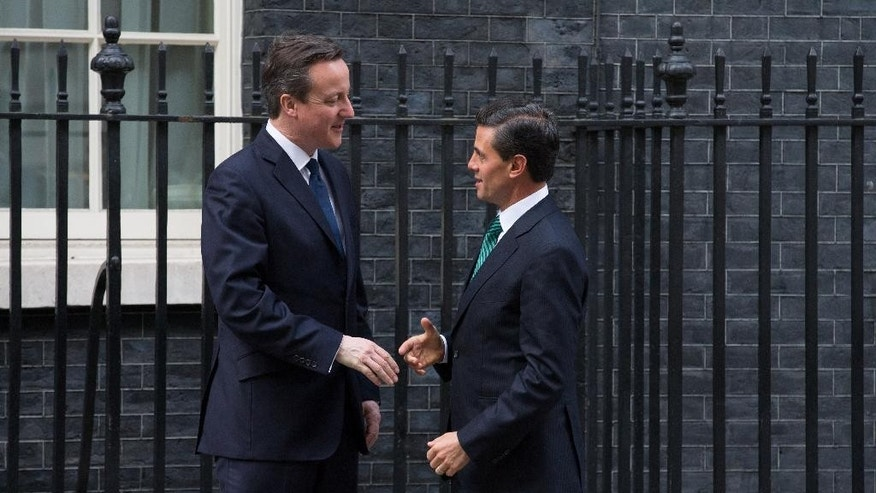 British Prime Minister David Cameron, left, greets the President of Mexico Enrique Pena Nieto outside 10 Downing Street, London, Wednesday, March 4, 2015. The Mexican President is on a three-day state visit to Britain. (AP Photo/Tim Ireland)