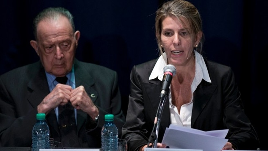 March 5, 2015: Sandra Arroyo Salgado, ex-wife of the late Argentina prosecutor Alberto Nisman, talks during a press conference beside forensic doctor Osvaldo Raffo, in Buenos Aires. (AP Photo/Natacha Pisarenko)