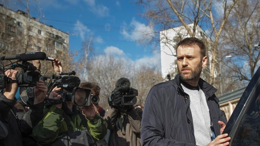 Russian opposition activist Alexei Navalny gets in a car as he leaves a detention center in Moscow, Russia, Friday, March 6, 2015. Navalny, Russia's leading opposition figure, was released after spending 15 days in custody for handing out leaflets in the subway. (AP Photo/Pavel Golovkin)