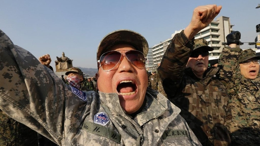 "South Korean Vietnam War veterans shout slogans during a rally denouncing the attack on U.S. Ambassador to South Korea Mark Lippert near the U.S. embassy in Seoul, South Korea, Friday, March 6, 2015. A knife attack on Thursday that injured Lippert is the latest act of political violence in a deeply divided country where some protesters portray their causes as matters of life and death. Thursday's attack, which prompted rival North Korea to gloat about ""knife slashes of justice,"" left deep gashes and damaged tendons and nerves. (AP Photo/Ahn Young-joon)"