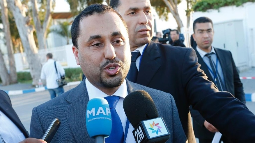 Dr. Saleh Almkhozom, Second Deputy Chairman of the Libyan General National Congress, speaks to the media outside the Palais des Congress of Skhirate 30 km south of Rabat, Morocco, Friday, March 6, 2015.  Talks between the UN Special Envoy to Libya Bernardino Leon, and Libyan Second Deputy Chairman Dr. Saleh Almkhozom will continue.  (AP Photo/Abdeljalil Bounhar)