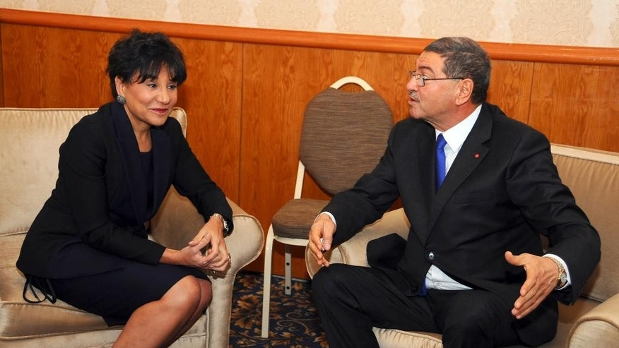 Tunisian Prime Minister Habib Essid, right,  talks to U.S. Commerce Secretary Penny Pritzker prior to a conference on investment and entrepreneurship in Gammarth near Tunis, Tunisia, Thursday, March 5, 2015. Tunisia is hosting a major conference on investment and entrepreneurship in hopes of stimulating an economy that has been hard bit by the turmoil following the revolution. (AP photo/Hassene Dridi)