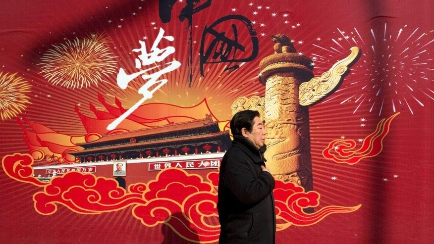 "In this Thursday, March 5, 2015 photo, a man walks past the words ""China Dream"" on a street in Beijing. Chinese President Xi Jinping's trademark ""China Dream of the Great Rejuvenation of the Chinese Nation"" and the ""Four Comprehensives"" that followed are just the latest examples of the slogans exhortations and statements of intent that are a mainstay of Chinese political life. (AP Photo/Ng Han Guan)"