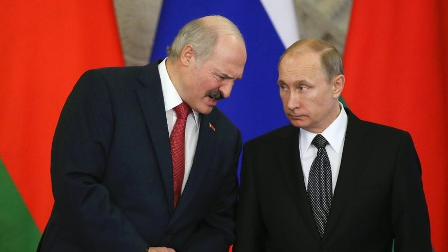 Russian President Vladimir Putin, right, listens to Belarusian President Alexander Lukashenko as they attend a signing ceremony of documents during a meeting in the Kremlin in Moscow,  Russia, Tuesday, March 3, 2015. (AP Photo/Sergei Karpukhin, Pool)