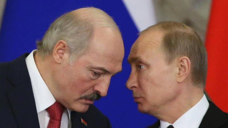 Russian President Vladimir Putin, right, speaks to Belarusian President Alexander Lukashenko during a meeting in the Kremlin in Moscow,  Russia, Tuesday, March 3, 2015. (AP Photo/Sergei Karpukhin, Pool)