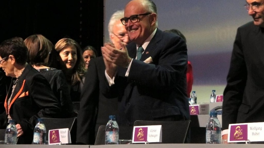 Former New York City Mayor Rudy Giuliani claps his hands at the start of a day-long conference on human rights organized by the Iranian exile opposition group National Council of Resistance of Iran on Saturday, March 7, 2015. Giuliani was one of the main speakers. (AP Photo/Frank Jordans)