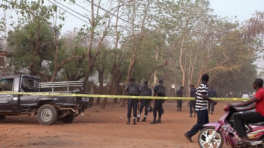 The road leading to a nightclub that was attacked by gunmen is blocked of by Mali police in Bamako, Mali, Saturday, March 7, 2015. At least one masked gunman sprayed bullets in a nightclub popular with foreigners in Mali's capital early Saturday, killing at least five people including a French person and a Belgian national, officials and witnesses said. (AP Photo/Baba Ahmed)