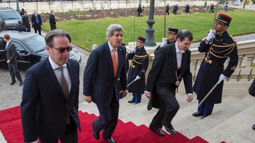 Secretary of State John Kerry arrives to meet with French Foreign Minister Laurent Fabius, on Saturday, March 7, 2015, in Paris. Kerry is meeting with the foreign ministers of France, Germany, and Britain to brief them on the status of nuclear negotiations with Iran. (AP Photo/Evan Vucci)