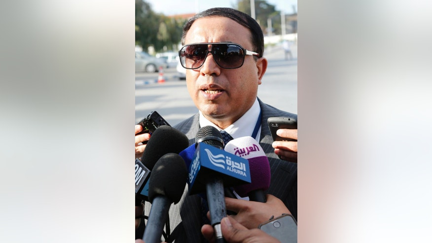 Acharif Alwafi Mohammed from the UN-recognized government in the eastern city of Tobruk speaks to the media outside the Palais des congress of Skhirate 30 km south of Rabat, Friday, March 6, 2015.  Talks between the UN Special Envoy to Libya Bernardino Leon, and Libyan Second Deputy Chairman Dr. Saleh Almkhozom will continue.  (AP Photo/Abdeljalil Bounhar)