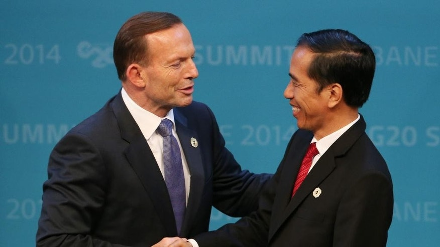 FILE - In this Nov. 15, 2014, file photo, Australian Prime Minister Tony Abbott, left, shakes hands with Indonesian President Joko Widodo at the G-20 summit in Brisbane, Australia. Australia's fight to save Andrew Chan and Myuran Sukumaran from imminent execution, and Indonesia's fight to preserve the sanctity of its own legal system, has devolved into a diplomatic battle rife with accusations of hypocrisy, power plays and moral superiority. (AP Photo/Rob Griffith, File)