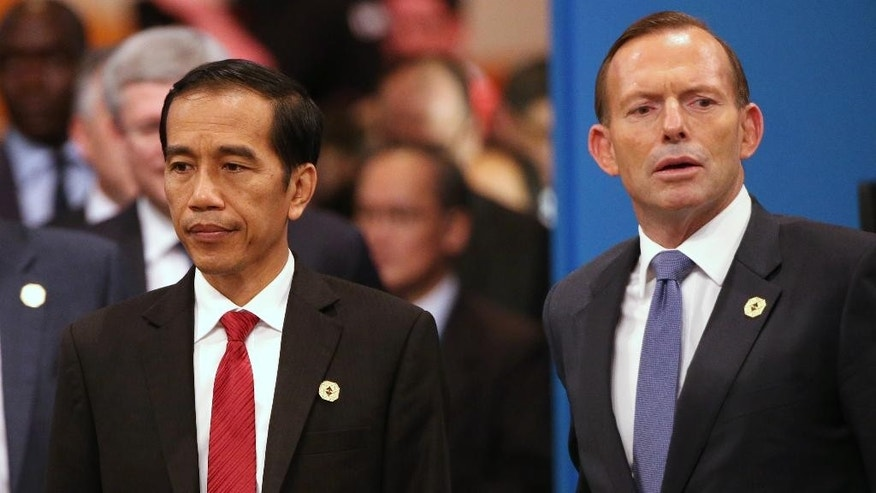 FILE - In this Nov. 15, 2014, file photo, Indonesian President Joko Widodo, left, and Australian Prime Minister Tony Abbott walk into a meeting room for a plenary session at the G-20 summit in Brisbane, Australia. Australia's fight to save Andrew Chan and Myuran Sukumaran from imminent execution, and Indonesia's fight to preserve the sanctity of its own legal system, has devolved into a diplomatic battle rife with accusations of hypocrisy, power plays and moral superiority. (AP Photo/Rob Griffith, Pool, File)
