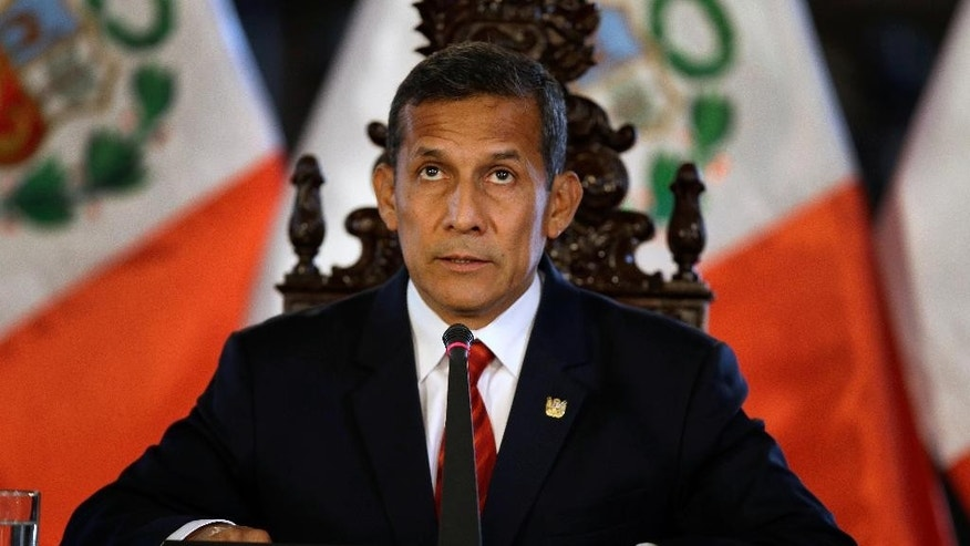 Peru's President Ollanta Humala listens to a journalist's question as he meets with the foreign press at the government palace in Lima, Peru, Monday, March 2, 2015. Humala demanded an answer from Chile's government after his government discovered an alleged spy case in which Peruvian sailors leaked military information to Chilean officials between 2005 and 2012. (AP Photo/Martin Mejia)