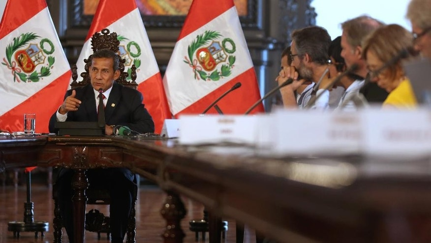 Peru's President Ollanta Humala speaks to the foreign press at the government palace in Lima, Peru, Monday, March 2, 2015. Humala demanded an answer from Chile's government after his government discovered an alleged spy case in which Peruvian sailors leaked military information to Chilean officials between 2005 and 2012. (AP Photo/Martin Mejia)