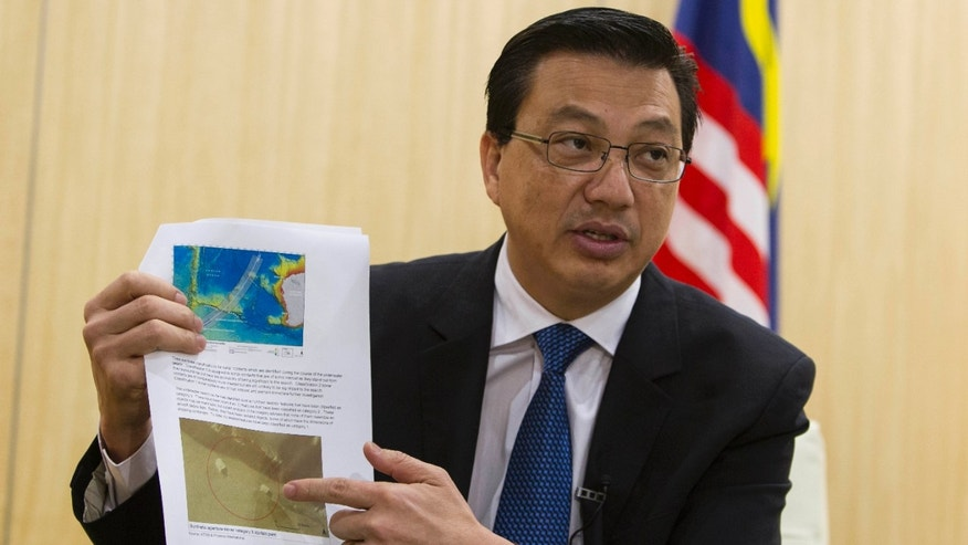 March 7, 2015: Malaysian Transport Minister Liow Tong Lai explains a weekly report on the missing Malaysia Airlines Flight 370 during an interview ahead of the one-year anniversary of the plane's disappearance.