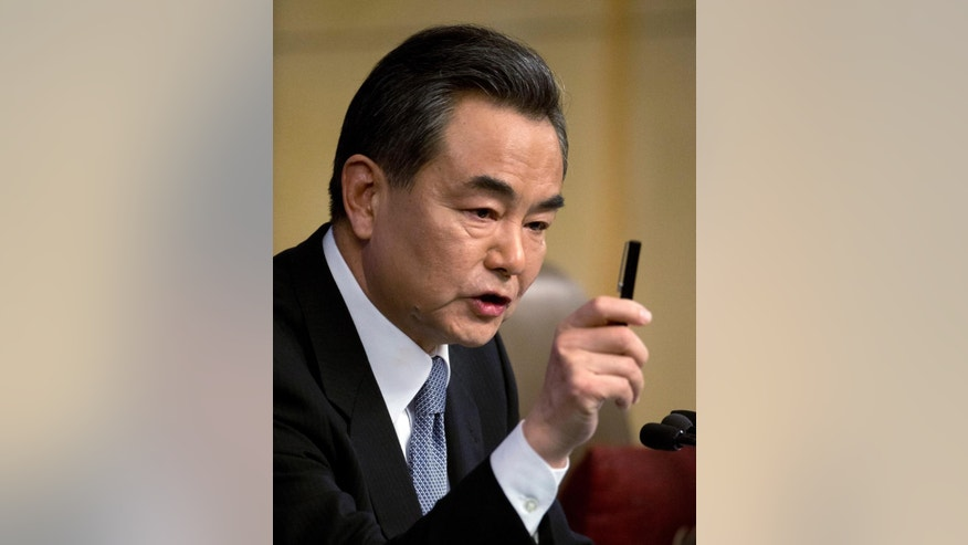 China's Foreign Minister Wang Yi gestures while speaking at a press conference in Beijing, Sunday, March 8, 2015. Wang renewed calls for Japanese leaders to abandon any attempt to water down the nation's guilt over its World War II aggression against China and others. Wang said that history continues to haunt relations between Beijing and Tokyo. He said Japanese leaders should drop their historical baggage and make a clean break with Japan's militaristic past. (AP Photo/Mark Schiefelbein)